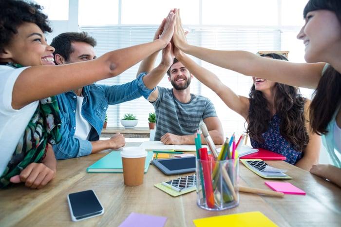 team working together at a desk