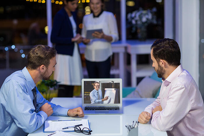 Businessmen having video conference in conference room at office-1