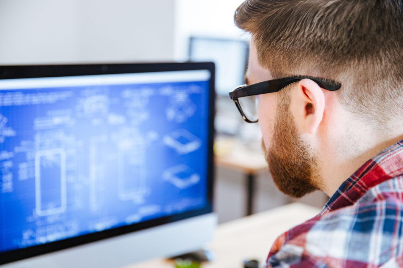 man staring at a computer screen